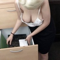 Bending inside the office showing her big boobs and nipples