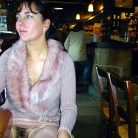 Flaunting her hairy pussy in a short skirt inside a restaurant