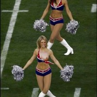 Cheer leader accidentally showing her breasts and nipples on the ground