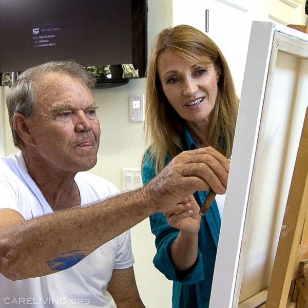 Glen Campbell and Jane Seymour painting