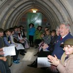 Cosheston VP School children huddle together inside the WWII air raid shelter at Carew Cheriton Control Tower.
