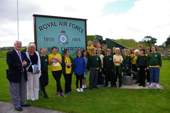 Second group children from St. Oswald's V A School with Head teacher Marjorie Brown and Control Tower President,                                            John Brock MBE, at the entrance to the Museum.