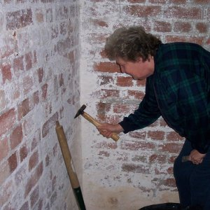 Scraping whitewash off the walls