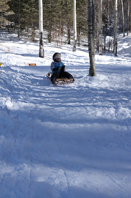 Looking for a free sledding near Santa Fe, I found it with year-round toilets and a picnic table.