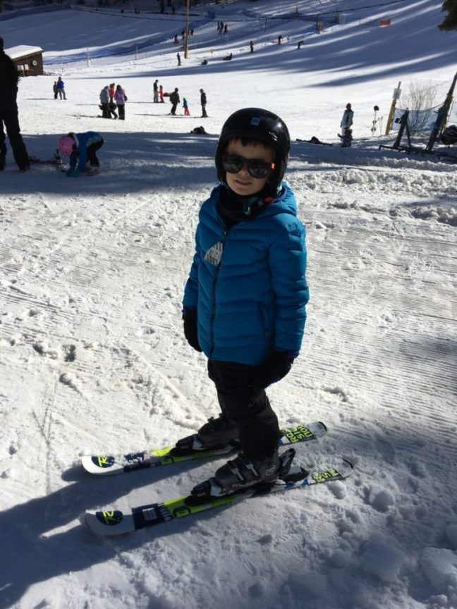He gets the gear on then decides that's enough for the day. Granlibakken-Tahoe, Lake Tahoe, family ski destinations,