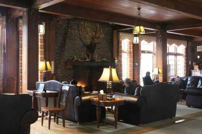 Enjoy a book by the fire when staying at Lake Quinault Lodge.