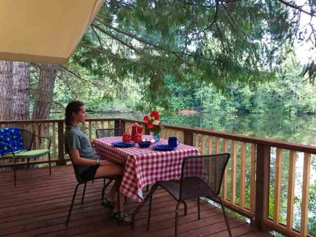 Enjoy the deck of the Canvas Cottage, one of the best places to camp with kids in Washington.
