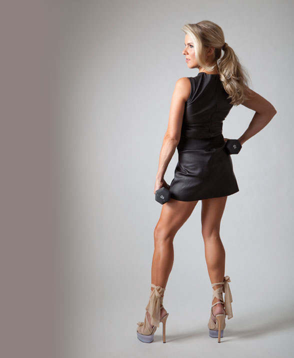 Cari Shoemate in a black Prada dress during a photoshoot for 002 magazines health and fitness issue