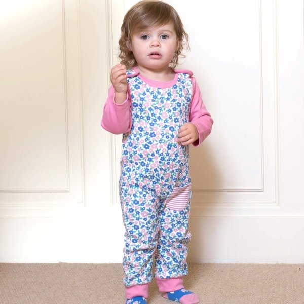 young girl wearing kite floral dungarees