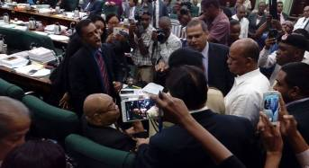 Chaos erupts in Parliament, police called in