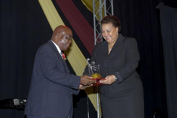 Bonti Liverpool.  Caption: Regional Unsung Hero Awardee 2012, Bonti Liverpool of Dominica (left) happily accepts his award from Managing Director, HR, CIBC FirstCaribbean Ella Hoyos