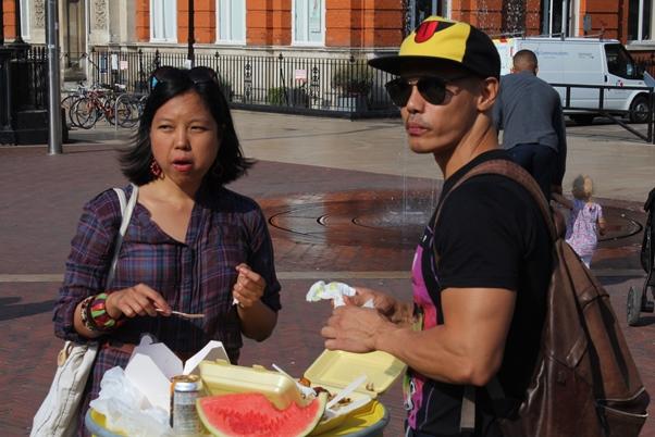Korean couple enjoying a meal to Caribbean steelpan music. Photo courtesy CaribDirect