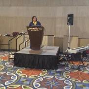 Commissioner Beverly Nicholson addresses audience at reception
