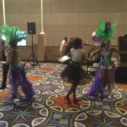 Caribbean Ritual Dancers gets the crowd into the USVI Nice Moment