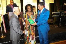 Author Glen Laman, Rep. Donna McLeod, and Prime Minister Holness