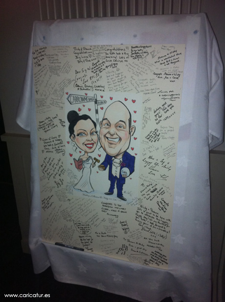 Wedding signing board by Allan Cavanagh covered in signatures