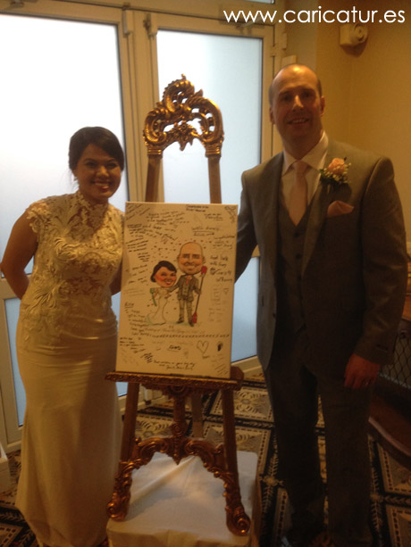 Newlyweds with their canvas wedding signing board caricature by Allan Cavanagh Caricatures Ireland