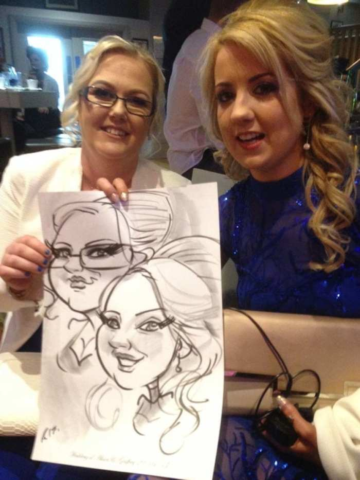Wedding guests in Claregalway hotel holding live caricature by Allan Cavanagh