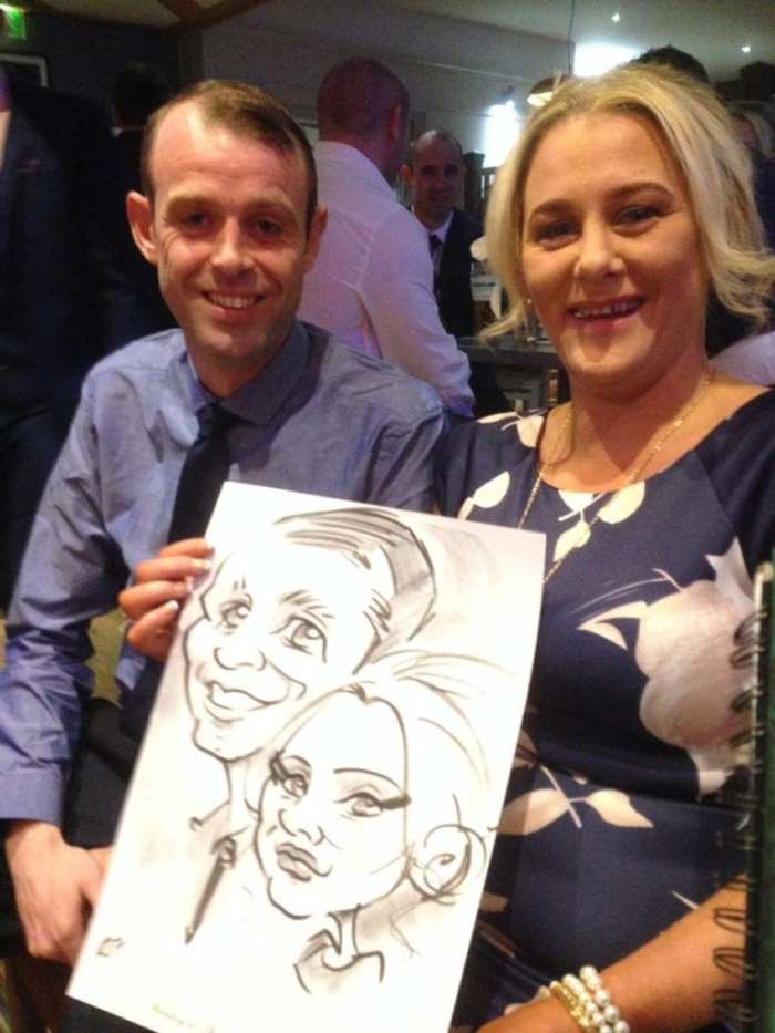 A couple with their caricature at a wedding, by Irish Caricature Artist Allan Cavanagh