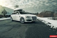 Custom White Audi A4 Carrying Color Matched Thule Roof