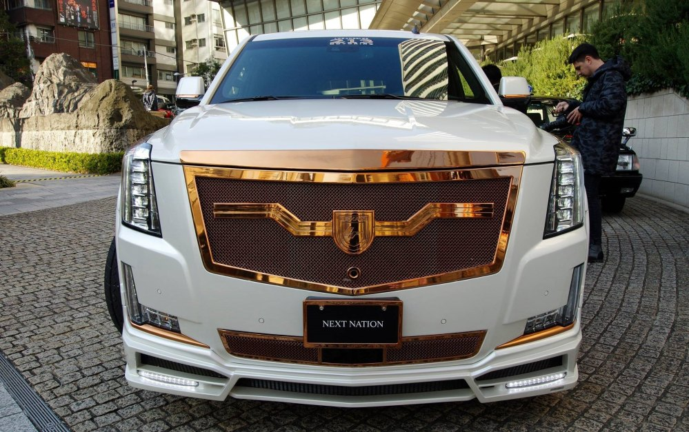 medium resolution of cadillac escalade esv with a body kit photo by lexani