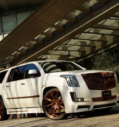 cadillac escalade with bronze custom painted wheels photo by lexani [ 2047 x 1265 Pixel ]