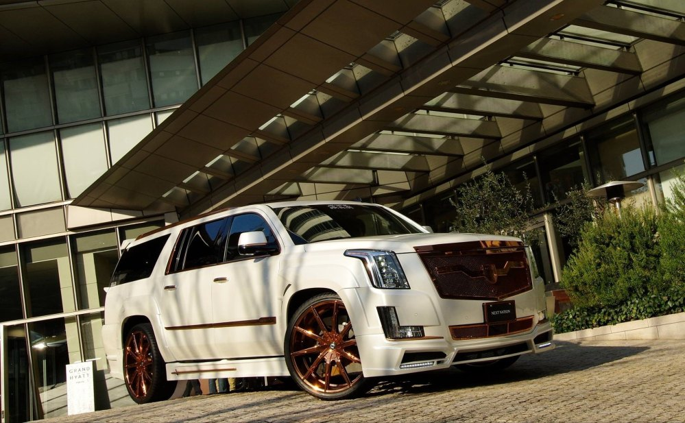 medium resolution of cadillac escalade with bronze custom painted wheels photo by lexani