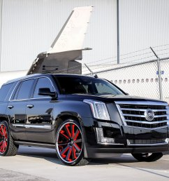 cadillac escalade on custom rims with red accents photo by exclusive motoring [ 2048 x 1335 Pixel ]