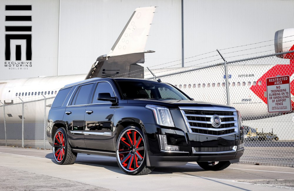 medium resolution of cadillac escalade on custom rims with red accents photo by exclusive motoring