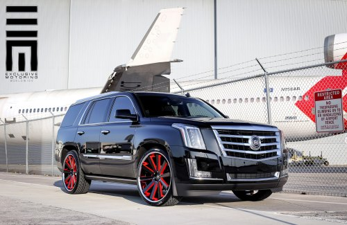 small resolution of cadillac escalade on custom rims with red accents photo by exclusive motoring