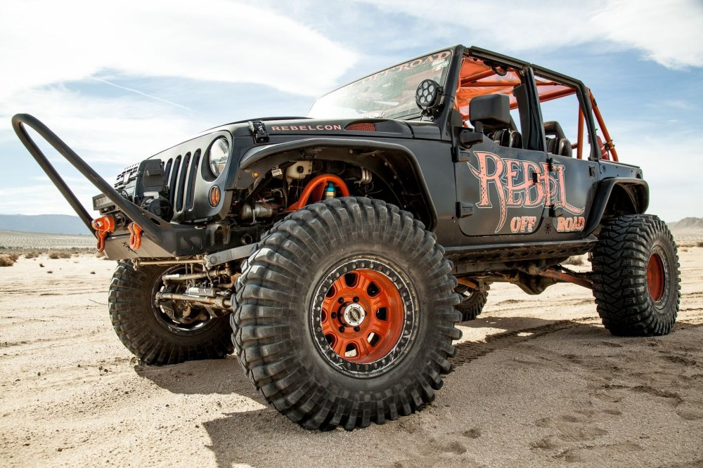 medium resolution of black lifted jeep wrangler rebelcon with custom front bumper photo by rebel off road