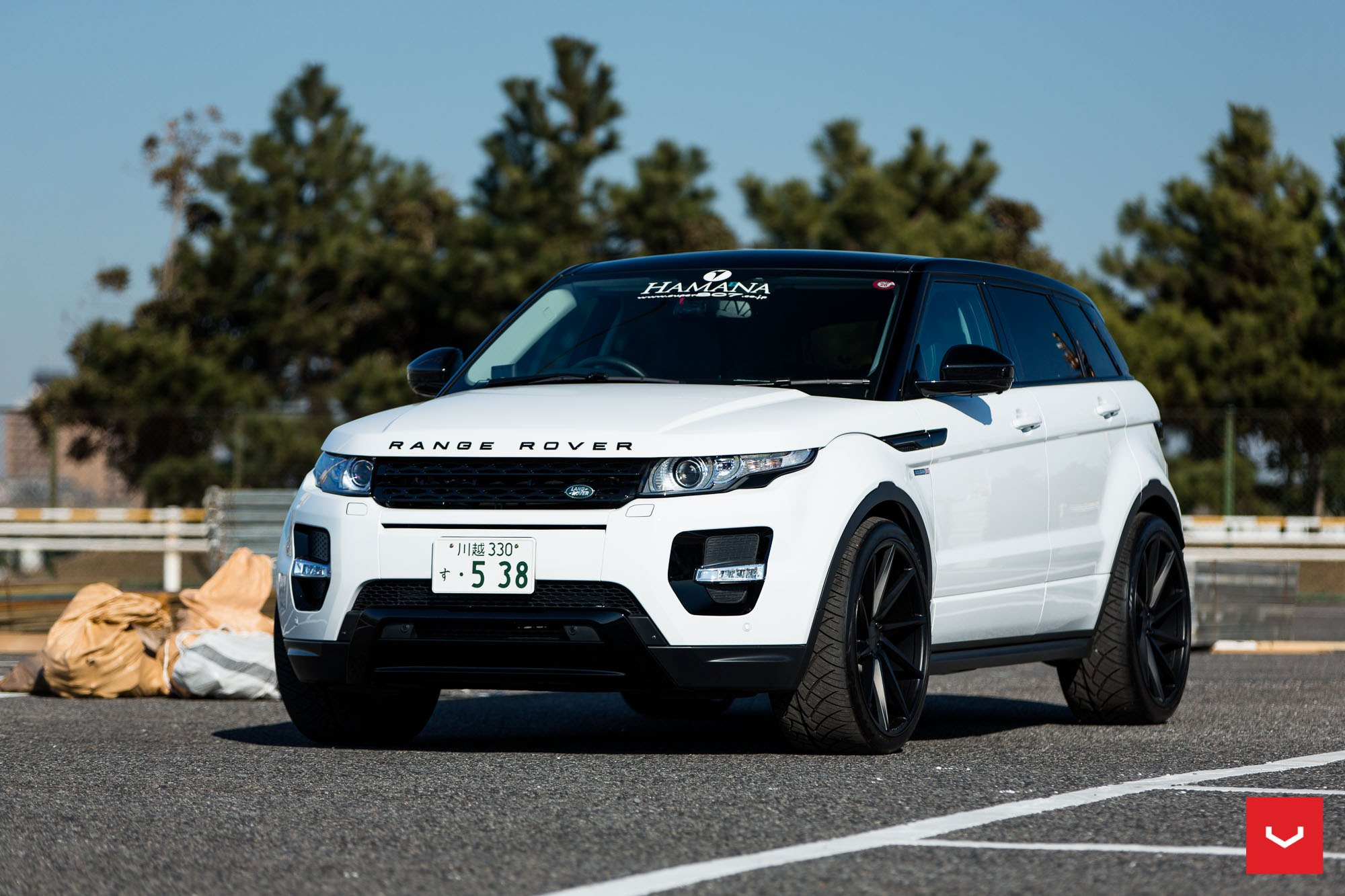 White Range Rover Evoque with a Wide Stance by Vossen — CARiD