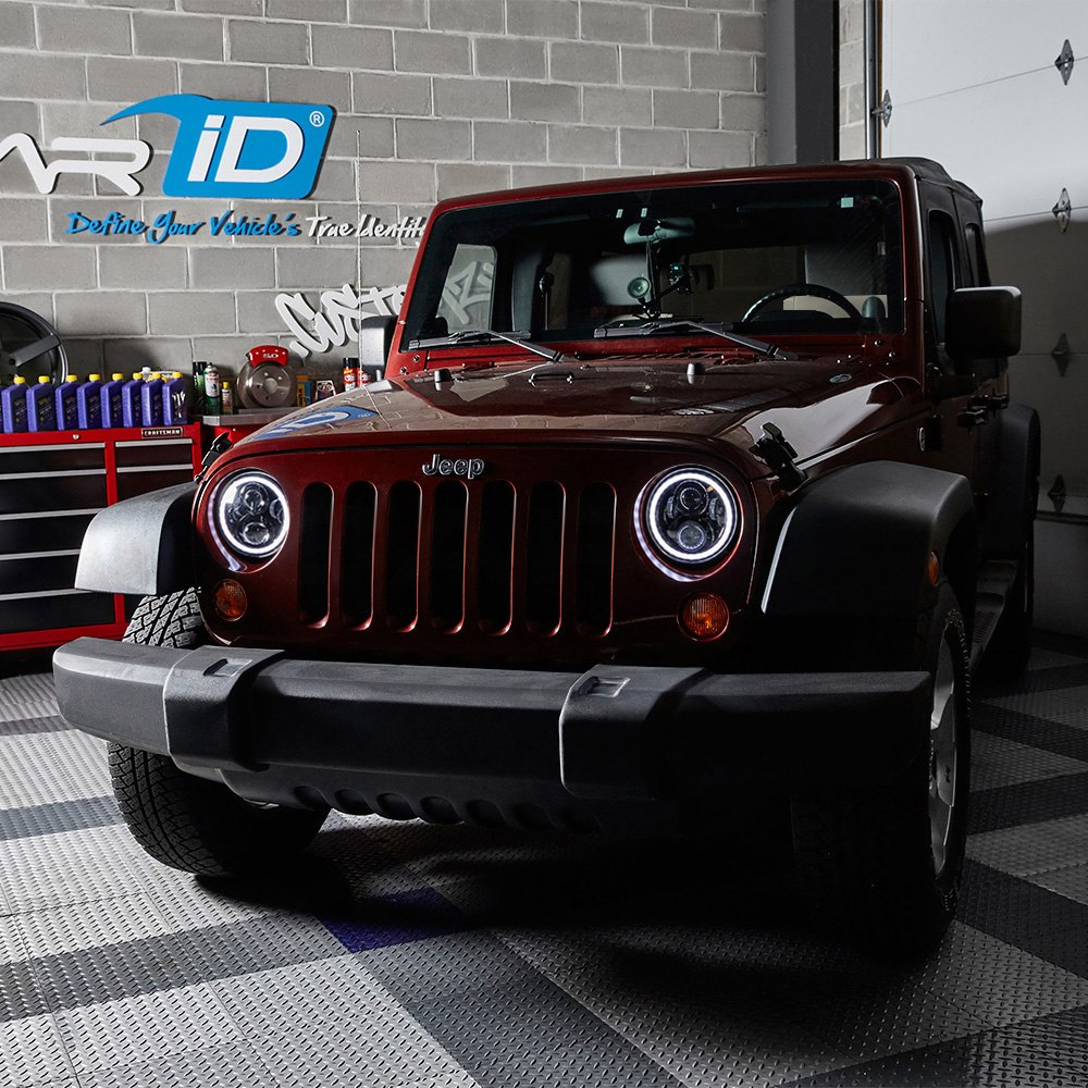 hight resolution of  7 round black projector led headlights with switchback halo installed on a jeep wrangler halo ring