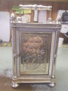 Carriage clock back door