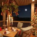 Outdoor porch decorated for christmas garland mantle candles by