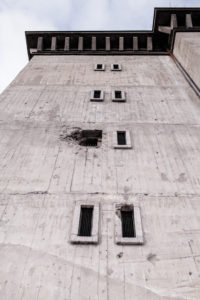 Pock-marked walls show battle damage from war
