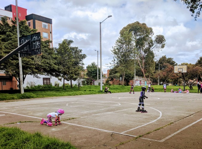 Kids learning to skate on inlines, Modelia, Bogota