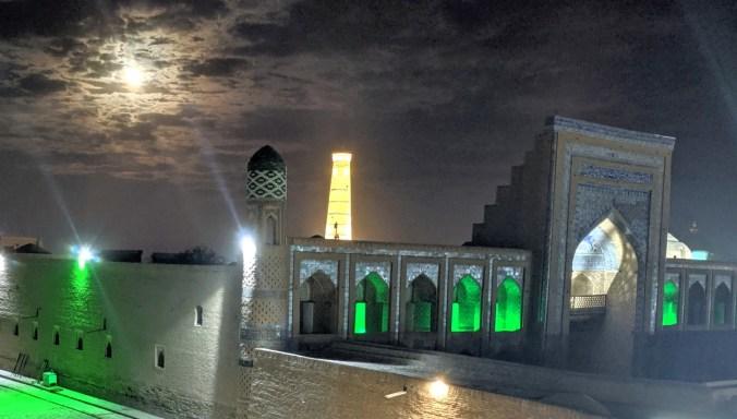 Khiva minaret along full moon.