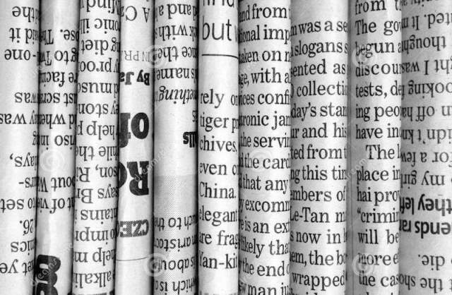 black-white-photograph-english-language-newspapers-folded-stacked-row-to-provide-background-30227572 2