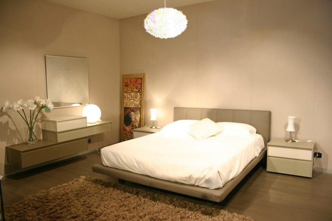 Camera con letto Sirio ecopelle  Carminati e Sonzogni