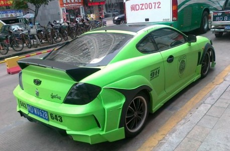 Hyundai Tiburon in Green with a body kit in China