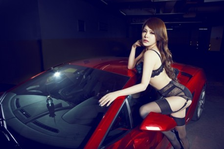 Sweet Chinese Girl heats up a Shiny Red Lamborghini Gallardo