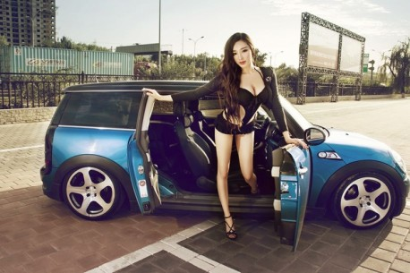 Sweet Chinese Girl opens all doors of a low riding Mini Clubman
