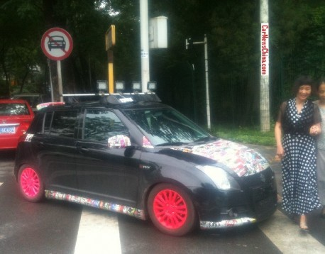 Suzuki Swift with Pink painted alloys in China