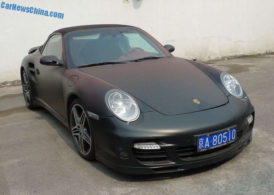 a stealthy porsche 911 turbo cabriolet supercar spotted in china on the beijing tuning street the good porsche is wrapped in an eye smothering matte black - Porsche 911 2014 Black