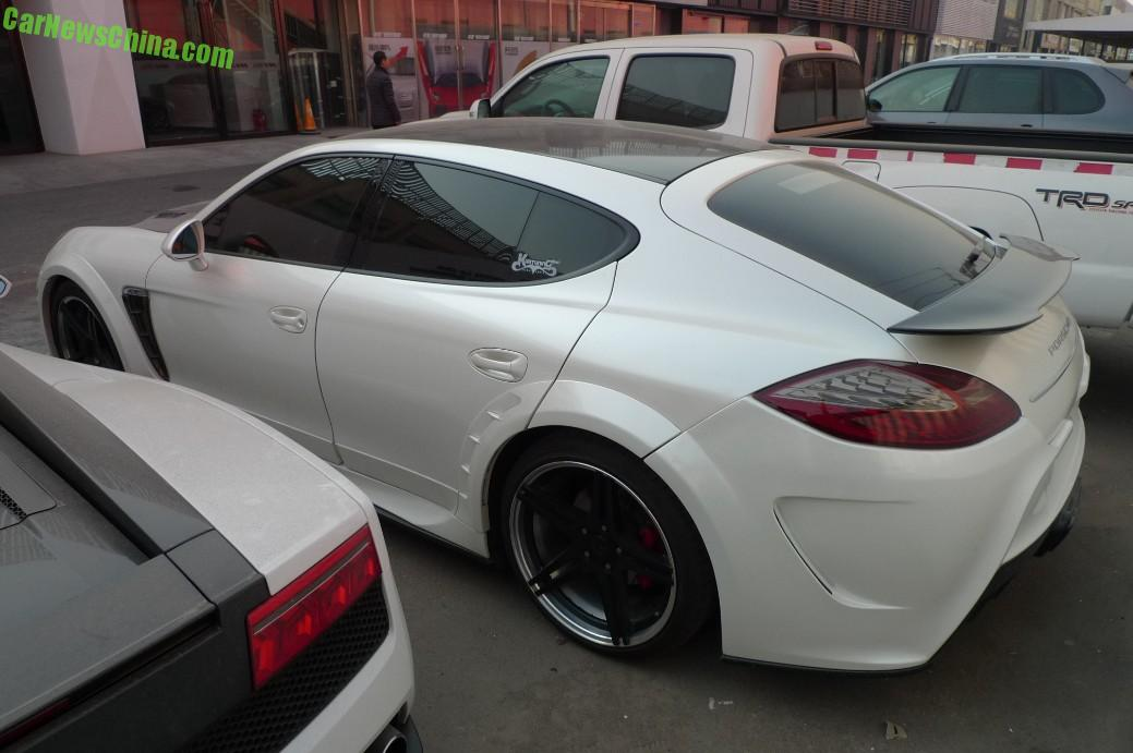 vents in the front fender and vents in front of the rear wheels and more vents again in the rear bumper this great looking car indeed is more vent than - Porsche Panamera Turbo 2014 White