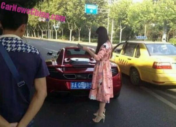 Chinese woman Crashes McLaren MP4-12C Spider