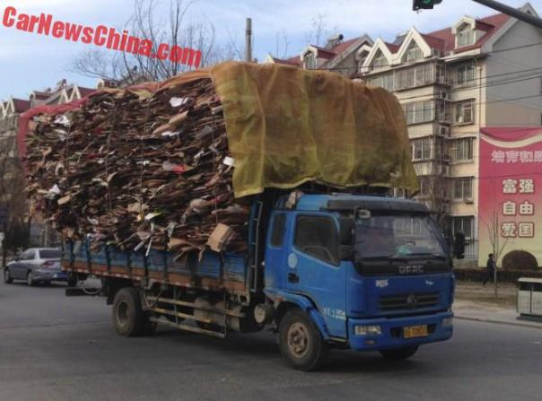 A slightly overloaded Carton Carrying Truck in China