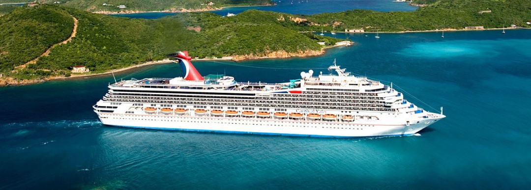 cruise ship carnival valor sailing among the islands