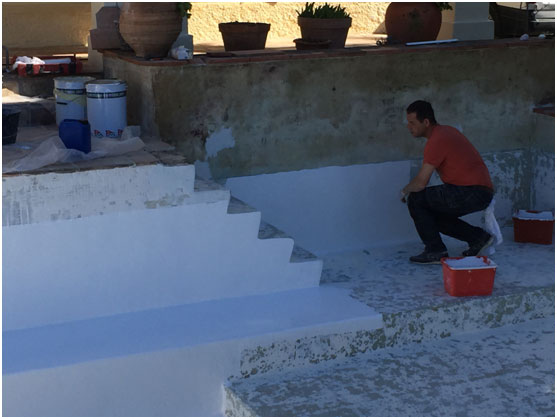 stripping back the pool, readying it for painting